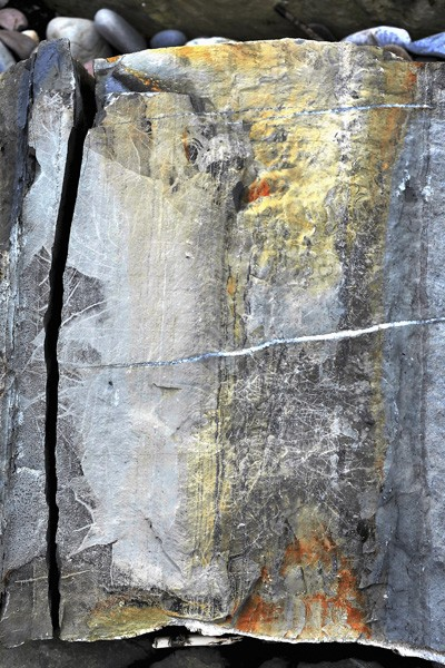 Photo art of split rock showing various colours